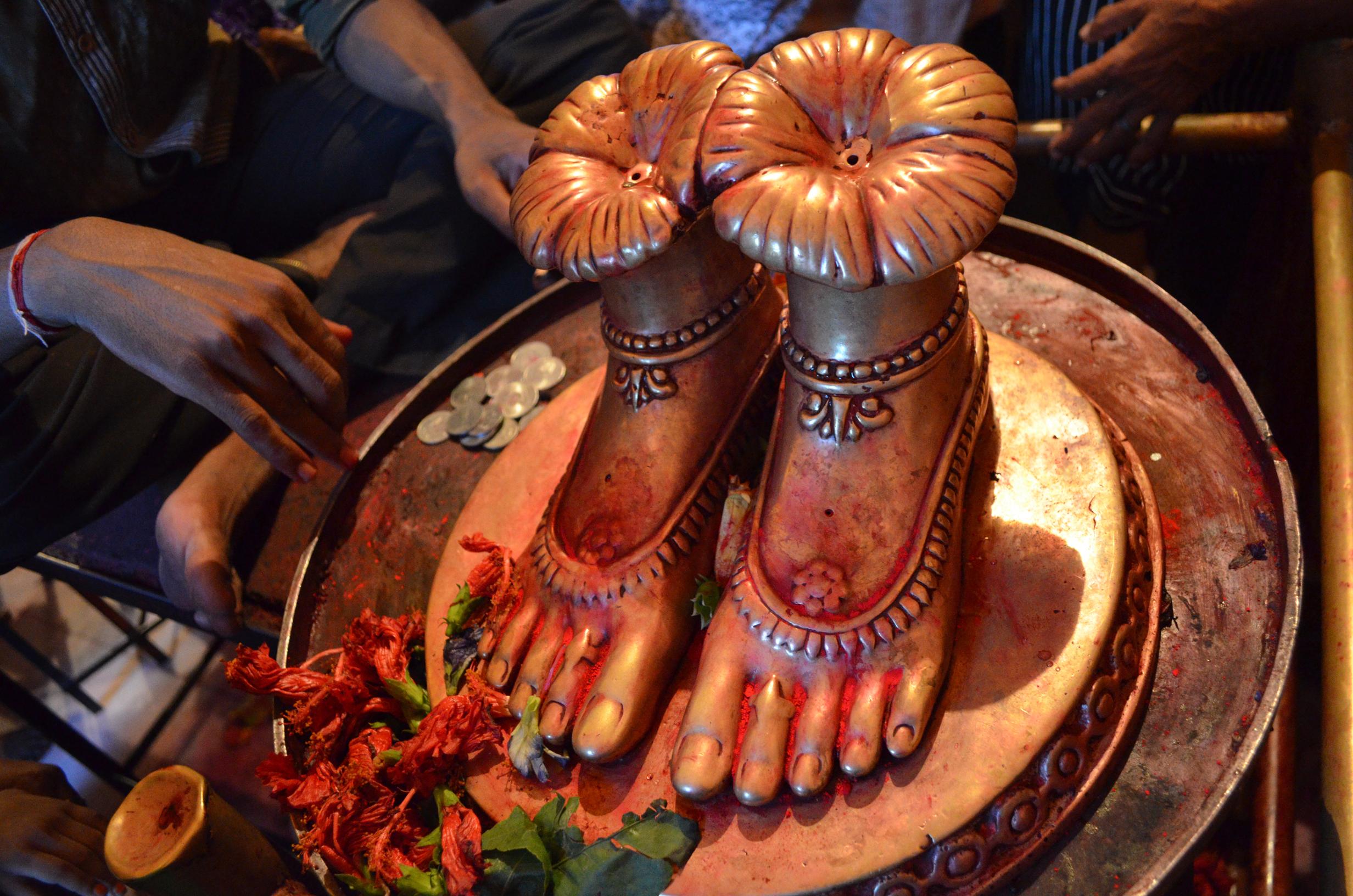 Tara Ma's feet receiving offerings at Tarapith