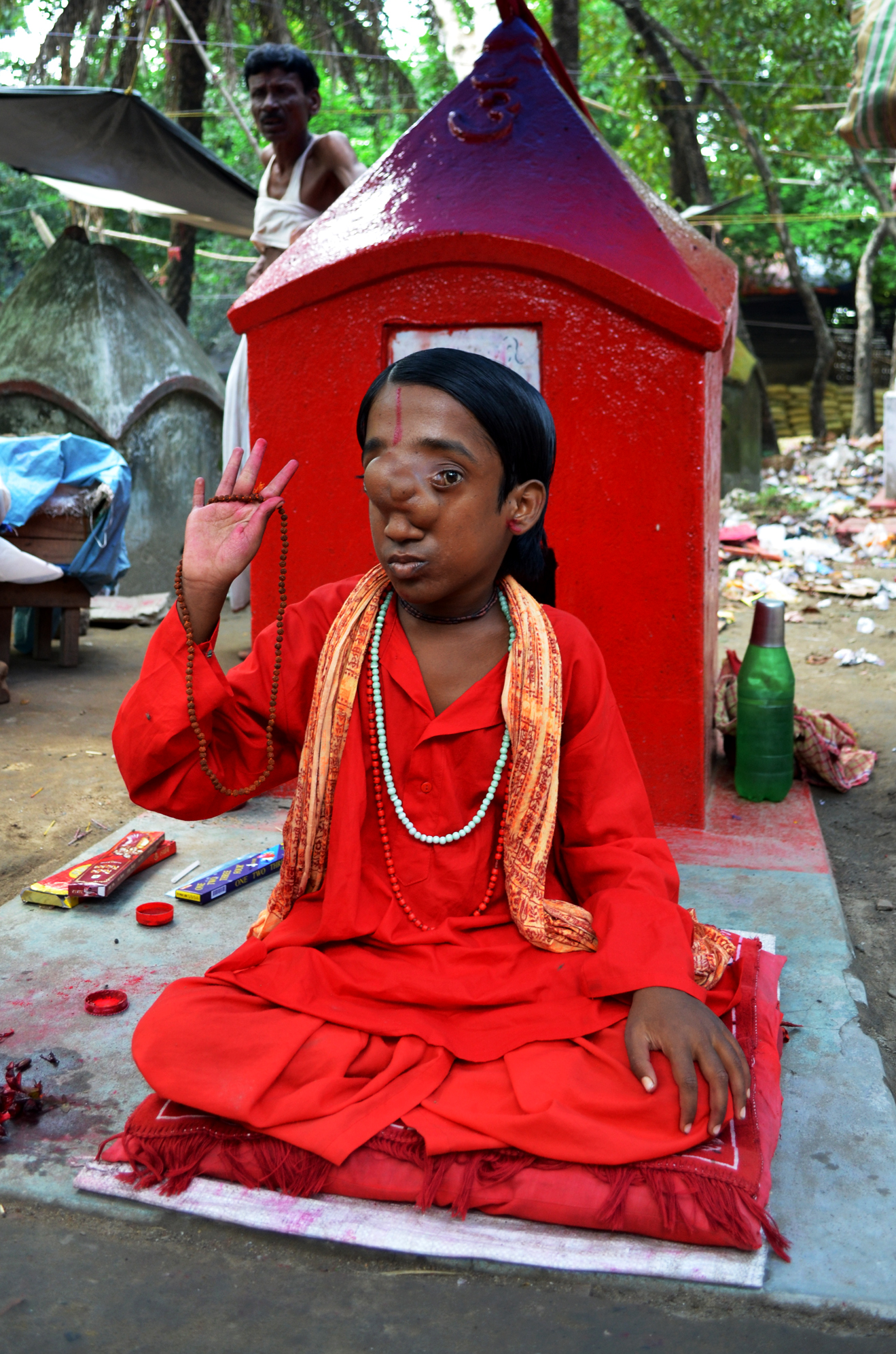 Ganesh Baba seated upon a Samadhi